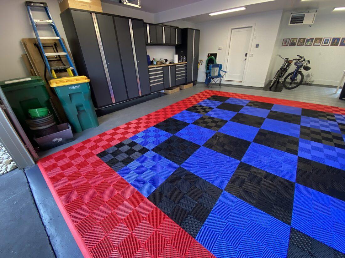 Red, blue, black, and silver garage floor tiles