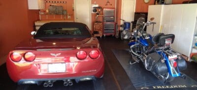 BLack BLT Rollout Flooring with motorcycle and red corvette