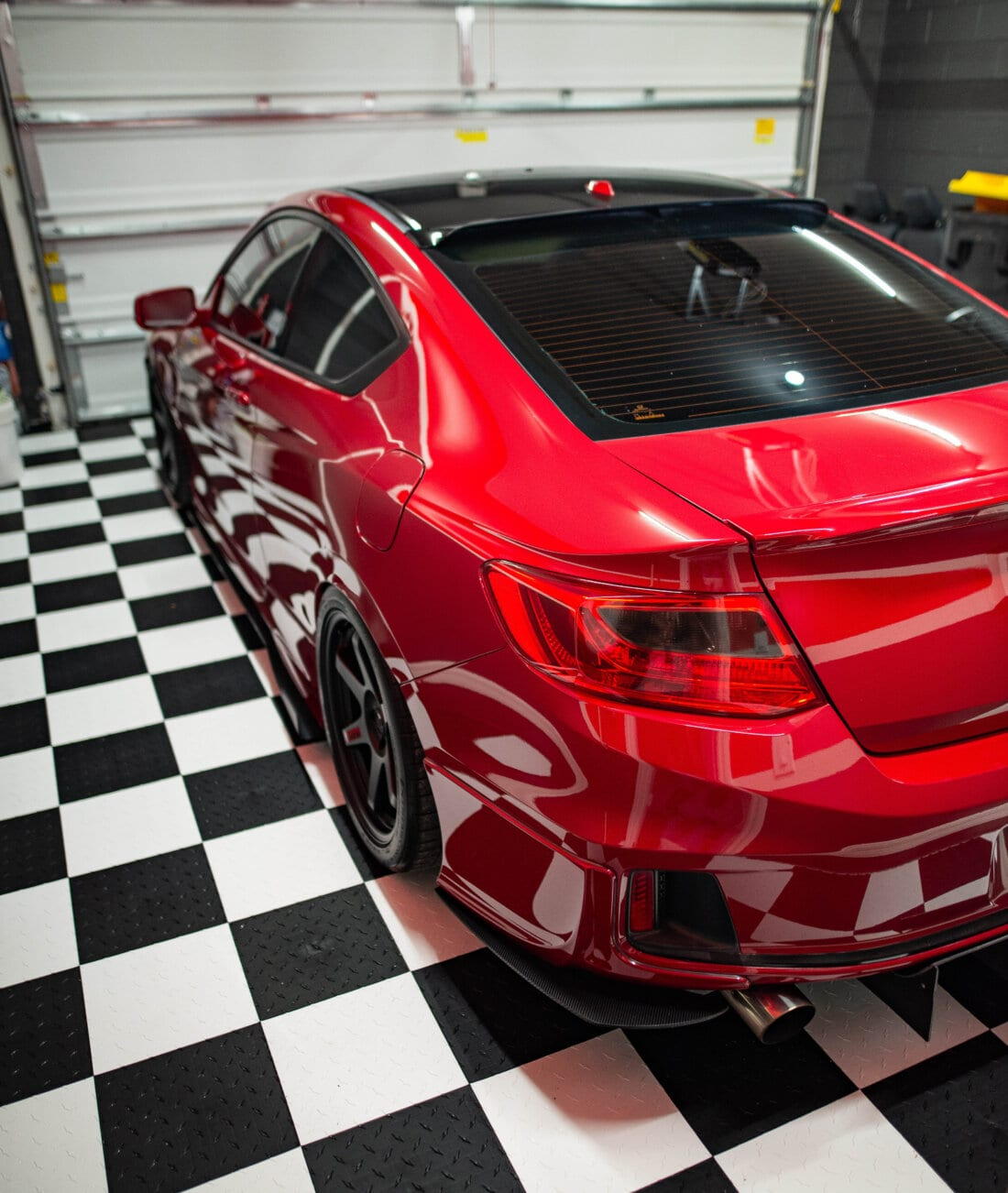 checkerboard tiles with red car