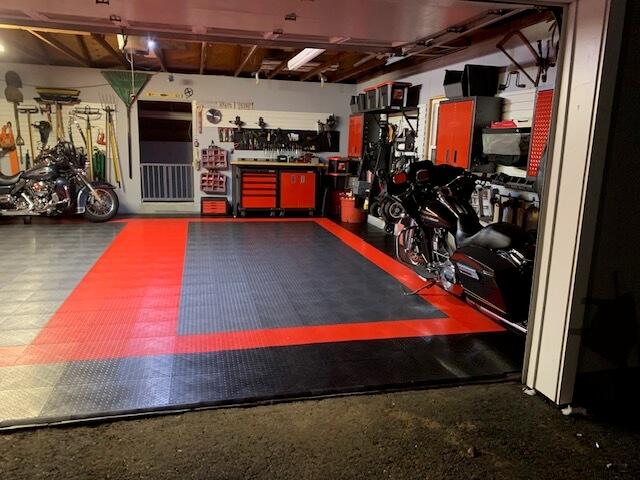Red, grey, and black garage floor tiles