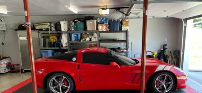 Red car on black and red garage floor tiles