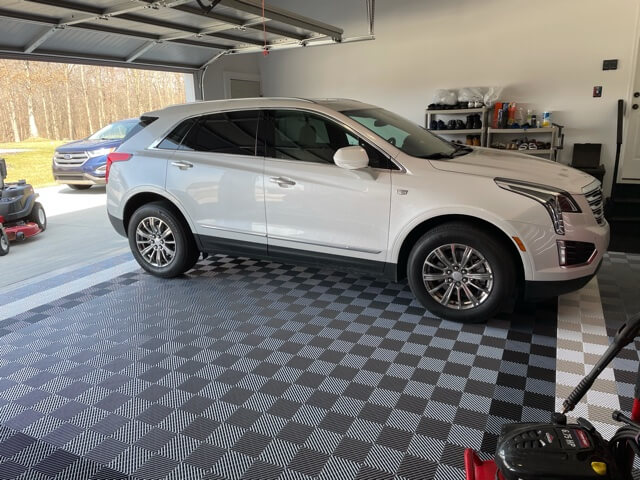 Grey garage floor tiles with white car