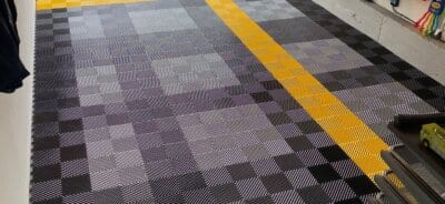 Black, silver, yellow ribbed garage floor tiles