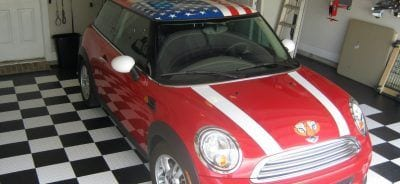 Mini Cooper With American Flag on Garage Floor Tiles