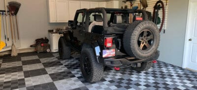 Free Flow Ribbed Garage Floor Tiles and Black Jeep