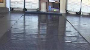 Rippled garage floor mat that will not lay flat