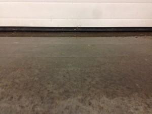 Water under garage door threshold